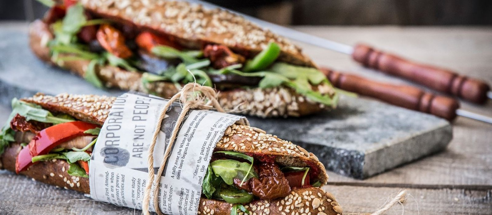 <span>Multi-grain Sub Sandwich with Roasted Vegetables, Arugula &amp; Sun-Dried Tomato</span>